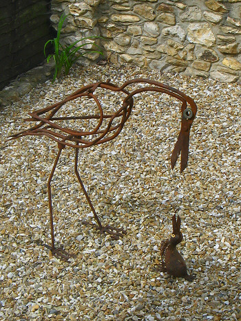 Bird and chick. Scrap metal.